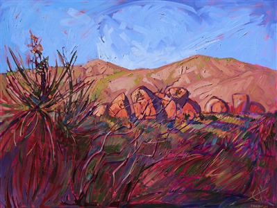 Landscape oil painting of Joshua Tree National Park with warm red hues against a bright blue summer sky