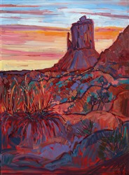 Monument Valley landscape with sunset light casting warm hues over red rocks by impressionist artist Erin Hanson